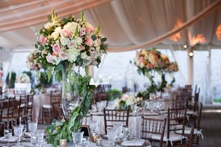 tall-floral-centerpieces-inspired-by-secret-garden-featuring-green-foliage-and-white-pink-flowers