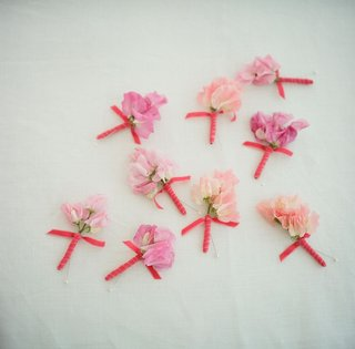 groomsmen-flowers-hand-tied-with-cerise-ribbon