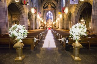 gold-columns-and-urns-at-church-aisle-entrance