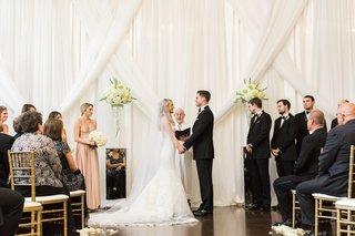 exchanging-vows-in-elegant-decor-biltmore-ballrooms-mirror-riser-drapery-on-wall-drapes