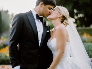bride-in-sweetheart-neckline-gown-groom-in-tuxedo-bride-and-groom-sharing-kiss-after-first-look