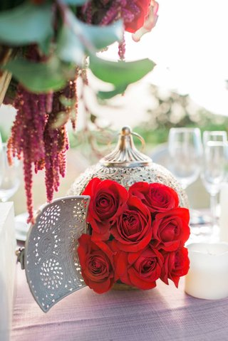 red-rose-bouquet-in-gold-lantern-on-pink-table-linen-in-rustic-vineyard-setting