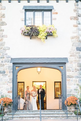 wedding-ceremony-bride-entrance-with-mother-and-father-parents-doorway-to-chateau-venue