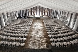 white-and-gray-wedding-ceremony-with-white-drapes-grey-carpet-and-branches