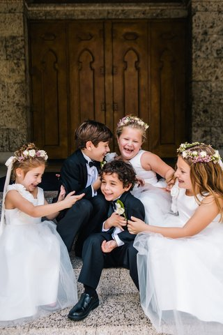 flower-girls-white-dresses-with-flower-crowns-ring-bearers-in-tuxes-laughing