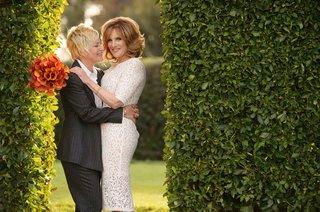 comedian-comedic-writer-carol-leifer-and-her-wife-lori-wolf-on-wedding-day-orange-calla-lily-bouquet