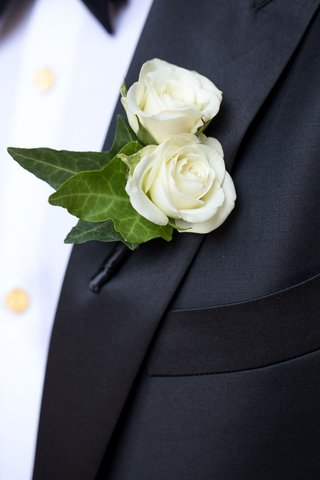 wedding-boutonniere-white-flowers-green-leaves-black-tuxedo-lapel