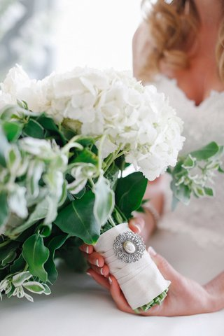 white-wedding-bouquet-with-green-accents-and-silver-brooch-with-pearl