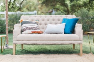 outdoor-lounge-space-gray-couch-colorful-pillows-california-winter-wedding-styled-shoot-boho-ranch