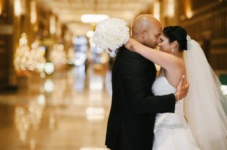 bride-and-groom-touch-noses-at-union-station