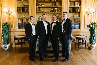 wedding-party-groomsmen-tuxedo-suits-bow-ties-in-library-at-oheka-castle