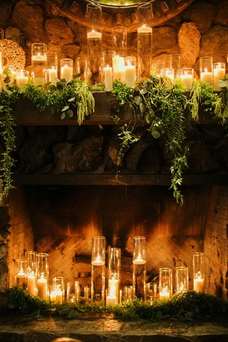 fireplace-full-of-candles-candles-on-mantle-with-greenery