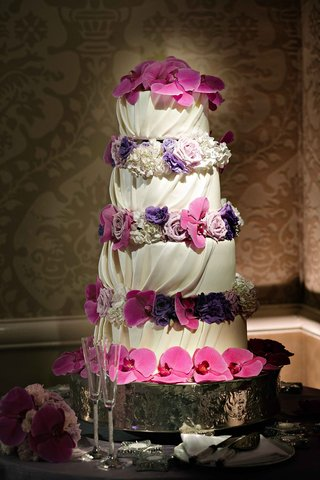 wedding-cake-with-draped-and-gathered-white-fondant-with-fresh-purple-flowers
