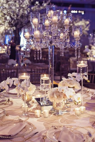 elegant-wedding-centerpiece-crystal-candelabra-with-orchids-and-roses