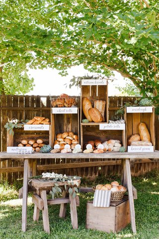 rustic-wood-food-display-with-croissants-and-bread-and-butter