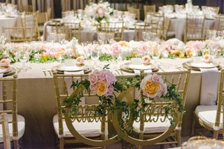 bright-florals-featuring-white-pink-and-orange-flowers-cover-white-table-linens-and-gold-chairs