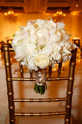brides-bouquet-of-white-roses-hydrangeas-orchids-calla-lilies-bound-with-pink-ribbon-rosary