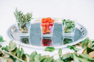 engagement-party-inspiration-cocktail-garnishes-raspberries-mint-and-rosemary-on-silver-platter