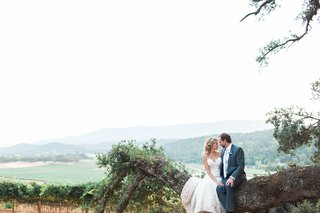 bride-and-groom-smiling-at-each-other-after-rustic-wedding-with-gorgeous-scenery-california-rustic