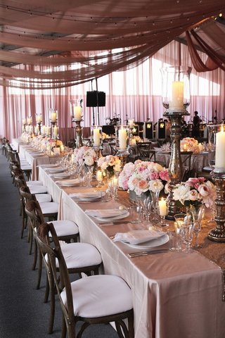 long-rectangular-wedding-reception-table-with-drapes-on-ceiling