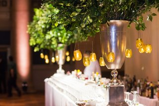 greenery-in-silver-vase-with-candle-votives-at-wedding-bar