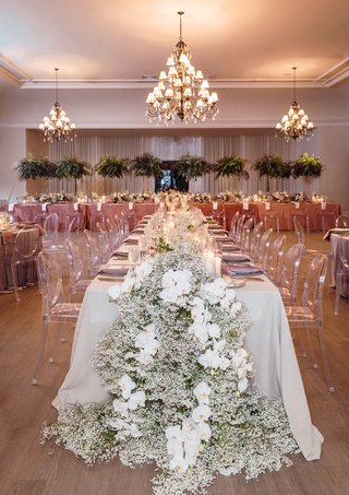the-bath-club-miami-wedding-taupe-linens-dusty-rose-linens-ghost-chairs-babys-breath-and-orchid