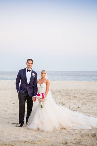 hockey-player-sheldon-souray-and-wags-star-barbie-blank-white-dress-and-pink-bouquets-by-beach