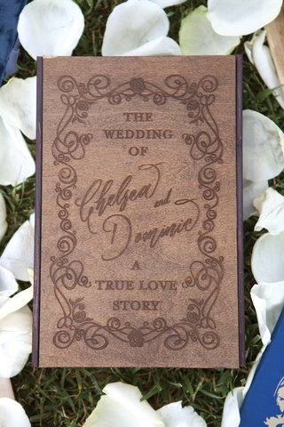 wedding-ceremony-program-styled-as-an-old-fashioned-storybook