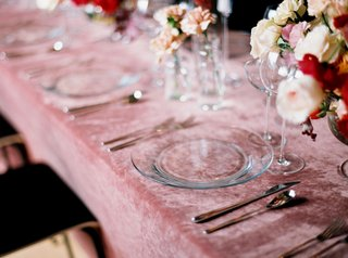 wedding-reception-pink-velvet-linen-tablecloths-with-clear-charger-plates-and-pink-ivory-flowers