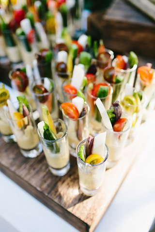 wedding-ceremony-snack-crudite-shooters-with-celery-carrots-jicama-tomatoes-zucchini-shot-glasses