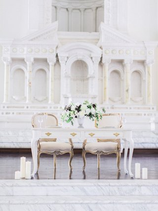 white-sweetheart-table-vintage-chairs-white-flowers-greenery-purple-leaves-at-vibiana