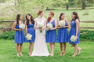 bride-with-bridesmaids-in-short-v-neck-gowns