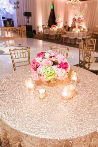 wedding-reception-table-with-sequin-linen-stitched-in-a-pattern-pink-florals