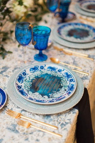 wedding-reception-china-blue-white-plate-with-blue-menu-card-blue-glassware-goblets