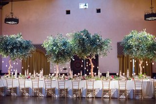 wedding-reception-trees-with-hanging-candles-as-centerpieces