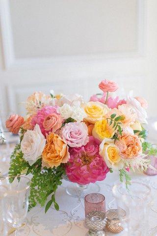 wedding-reception-centerpiece-pink-peony-yellow-rose-orange-garden-rose-ranunculus-greenery