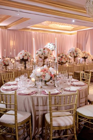 wedding-reception-gold-chairs-soft-linens-tall-taper-candles-gold-footed-vessels-pink-white-flowers