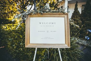 printed-wedding-welcome-sign-in-gold-frame-with-greenery-on-top