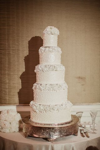 wedding-cake-white-with-design-and-monogram-with-fresh-flowers-alternating-each-layer