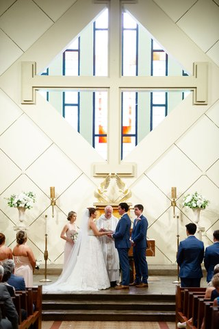 bride-and-groom-at-altar-catholic-church-classic-traditional-wedding-ceremony-personal-vows