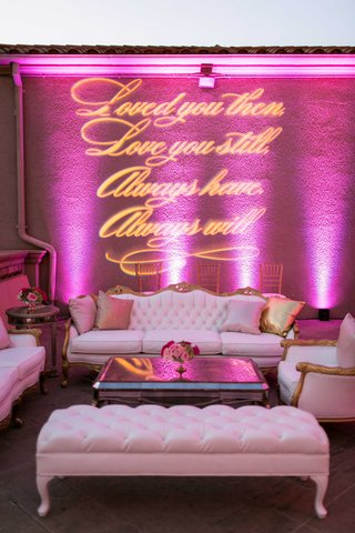wedding-lounge-with-white-and-gold-furniture-mirror-coffee-table-gobo-lighting-sign-pink-uplights