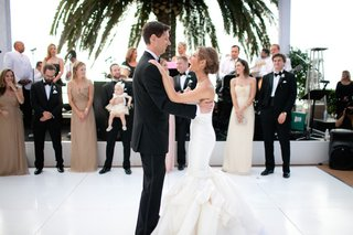 bride-and-groom-dancing-on-white-tiled-floor