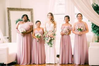 bridesmaids-in-mismatched-dusty-rose-morilee-dresses-bride-in-pronovias-wedding-dress-with-lace-top