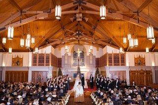 new-years-eve-wedding-ceremony-at-catholic-church-minimal-decor-priest-bridesmaids-groomsmen