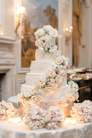 five-layer-regal-wedding-cake-with-fresh-flowers-cascading-down-pink-and-white-flower-decor