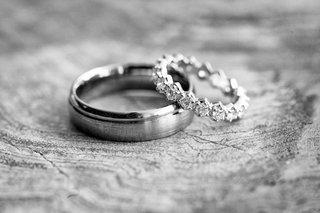 black-and-white-photo-of-wedding-band-and-eternity-band