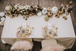 wedding-reception-sweetheart-table-gold-pumpkin-white-pumpkin-charcoal-candle-on-gold-candlestick