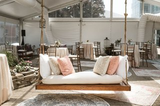 wedding-reception-tent-lounge-area-wood-daybed-swing-vintage-area-rugs