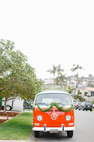 1971-candy-apple-red-volkswagen-bus-for-couple-and-bridal-party-at-waterfront-wedding