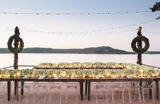 lucite-chairs-around-horseshoe-shaped-wood-table